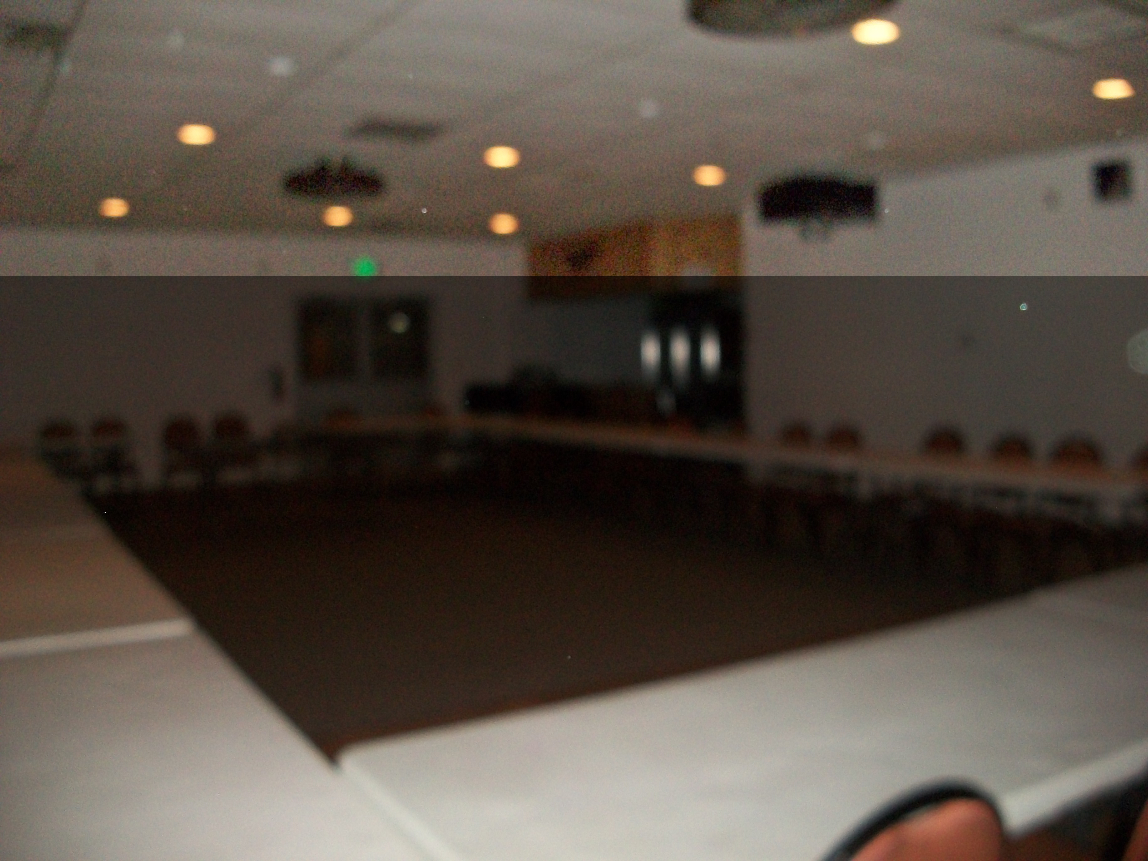 A picture of the large banquet room, taken from another angle, with its tables arranged in a large square for meetings. The room's primary entrance is in the background.